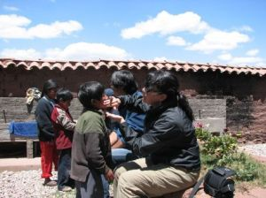 Putting face cream on the kids in Peru