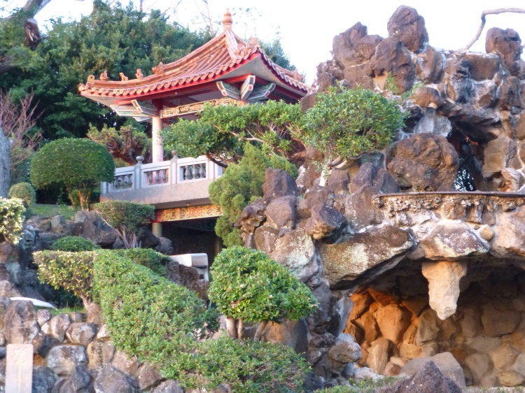 The manicured grounds behind Guandu temple