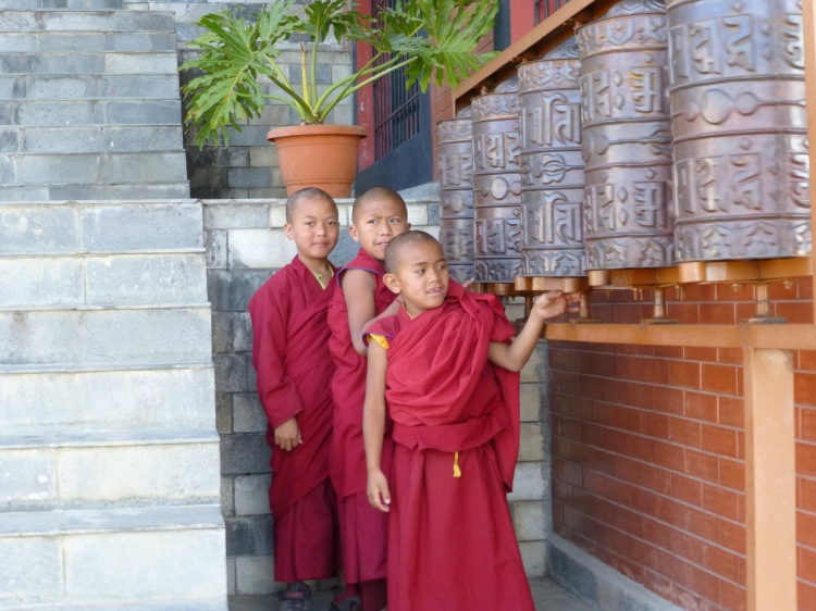 Young monks at the prayer wheels