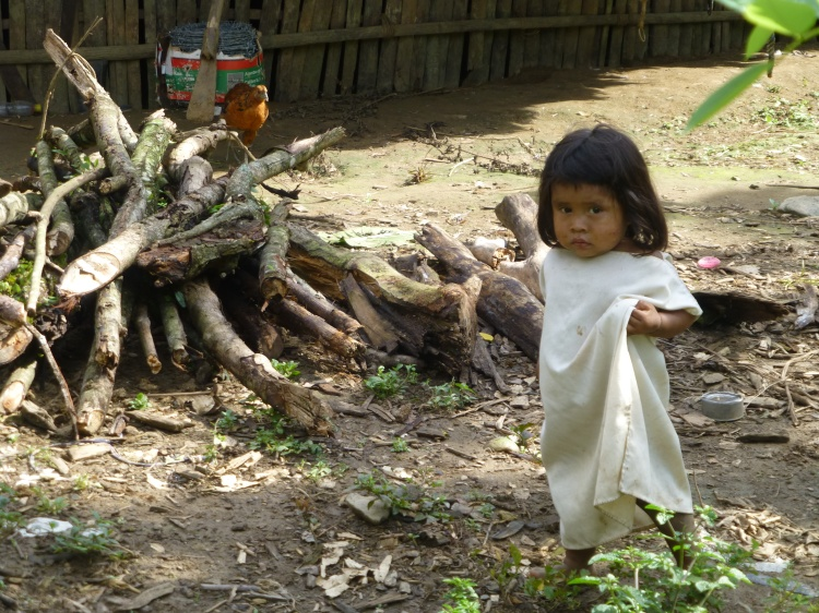 A Kogi child outside her family's home
